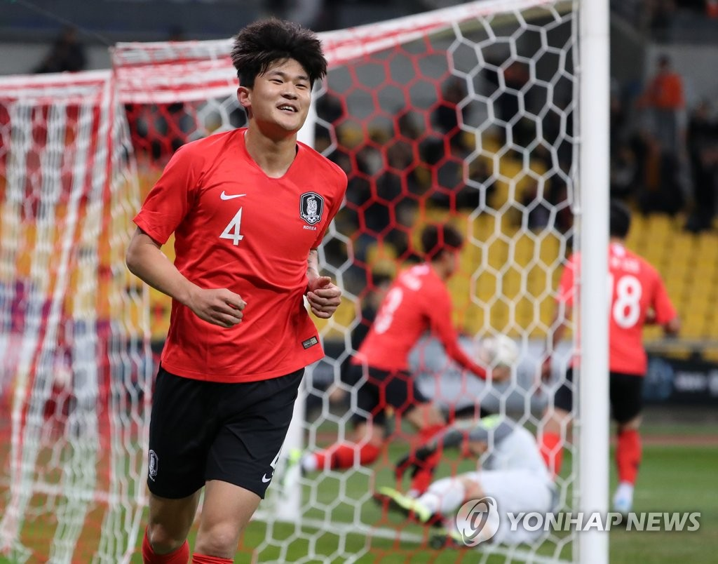 Kim Min-jae of South Korea celebrates his goal against China during the teams' second match at the East Asian Football Federation (EAFF) E-1 Football Championship at Busan Asiad Main Stadium in Busan, 450 kilometers southeast of Seoul, on Dec. 15, 2019. (Yonhap)