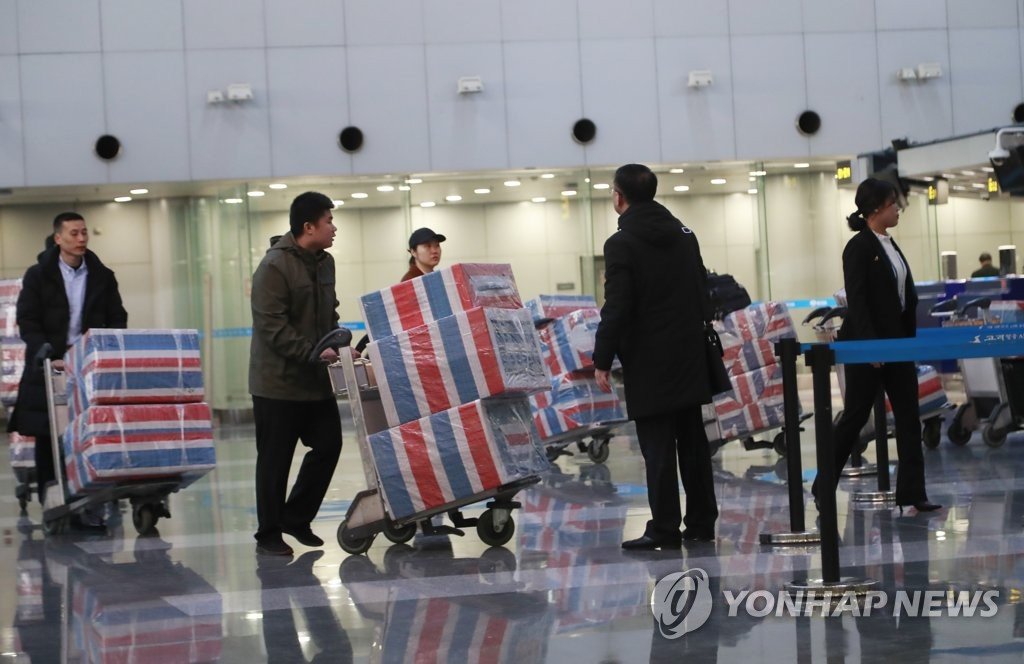 People assumed to be North Korean overseas laborers prepare to return home at Beijing Capital International Airport on Dec. 21, 2019, one day ahead of the U.N. Security Council Resolution 2397 deadline, which calls on member states to repatriate all North Koreans earning income in their jurisdictions. (Yonhap)