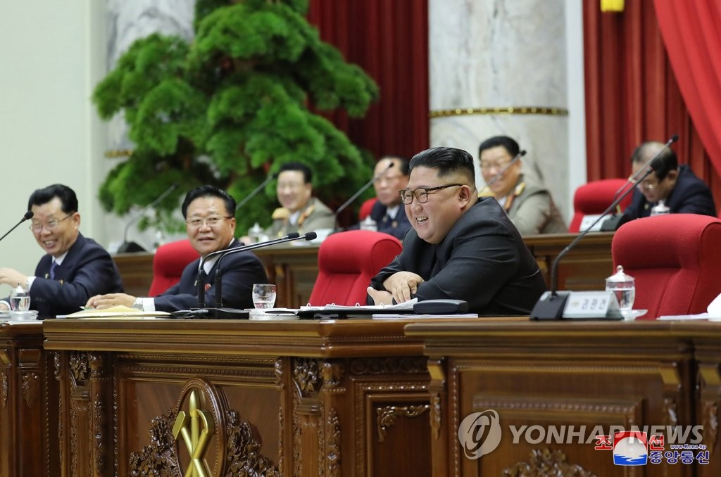 North Korean leader Kim Jong-un (R) smiles during a meeting of the ruling Workers' Party on Dec. 31, 2019, in this photo disclosed by its official Korean Central News Agency on Jan. 1. (For Use Only in the Republic of Korea. No Redistribution) (Yonhap)