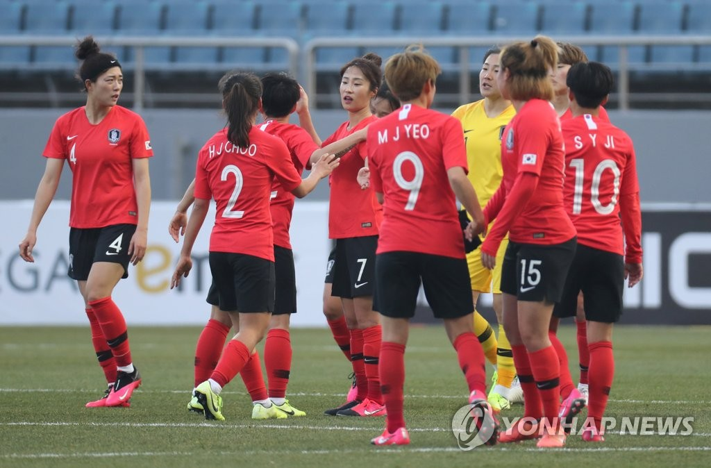 In this file photo, from Feb. 9, 2020, South Korean players celebrate their 3-0 victory over Vietnam in their Group A match in the third round of the Asian qualifying for the 2020 Tokyo Olympics at Jeju World Cup Stadium in Seogwipo, Jeju Island. (Yonhap)