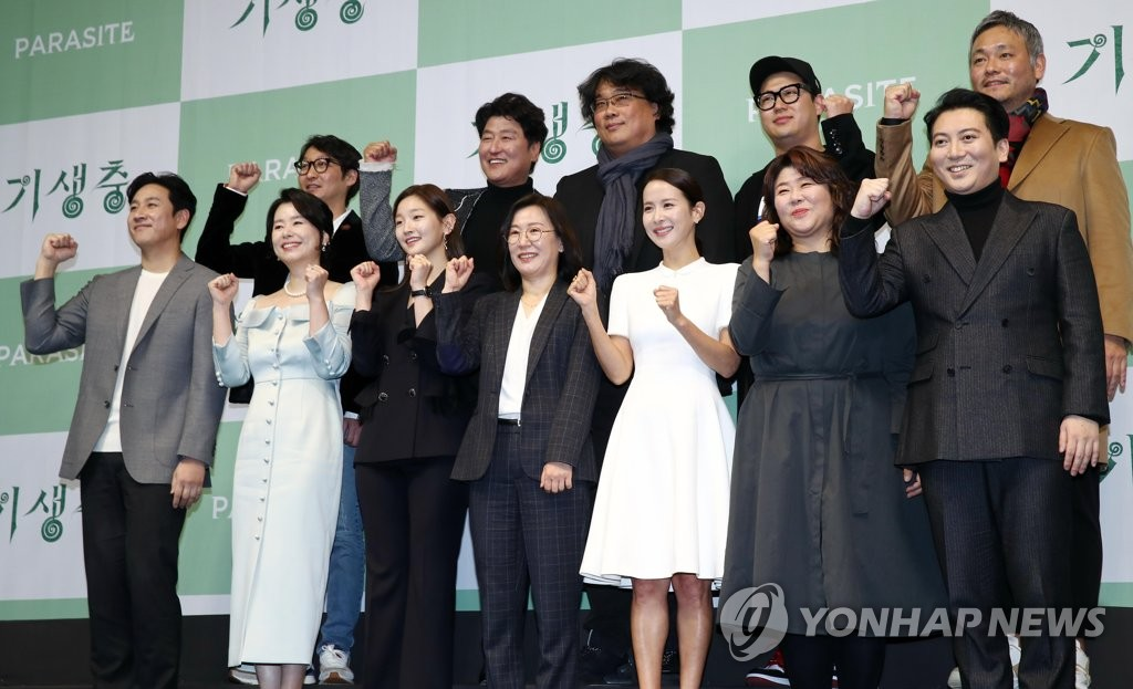 "The production crew and cast of ""Parasite"" pose for photos at a press conference in Seoul on Feb. 19, 2020. (Yonhap)"