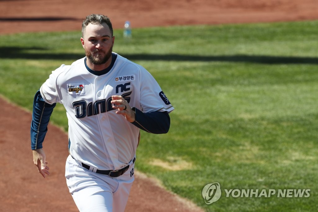 In this file photo from March 16, 2020, Mike Wright of the NC Dinos (R) runs in the outfield at Changwon NC Park in Changwon, 400 kilometers southeast of Seoul. (Yonhap)