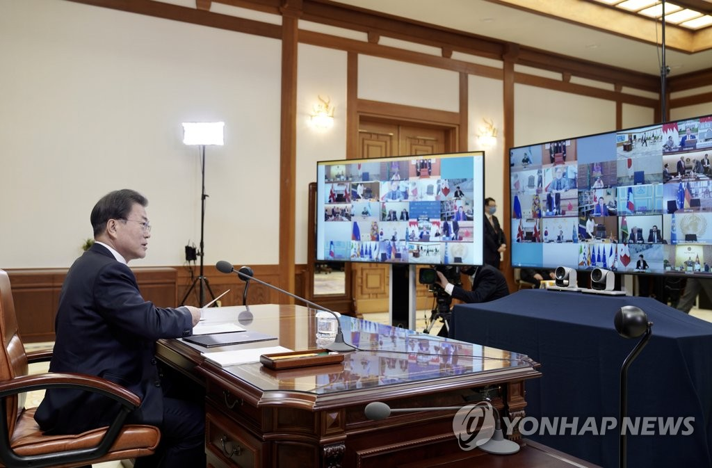 South Korean President Moon Jae-in takes part in a G-20 teleconference at his office in Seoul on March 26, 2020, in this photo provided by Cheong Wa Dae. (PHOTO NOT FOR SALE) (Yonhap)