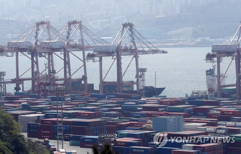 The file photo, taken May 1, 2020, shows stacks of import-export cargo at South Korea's largest seaport in Busan, 450 kilometers south of Seoul. (Yonhap)