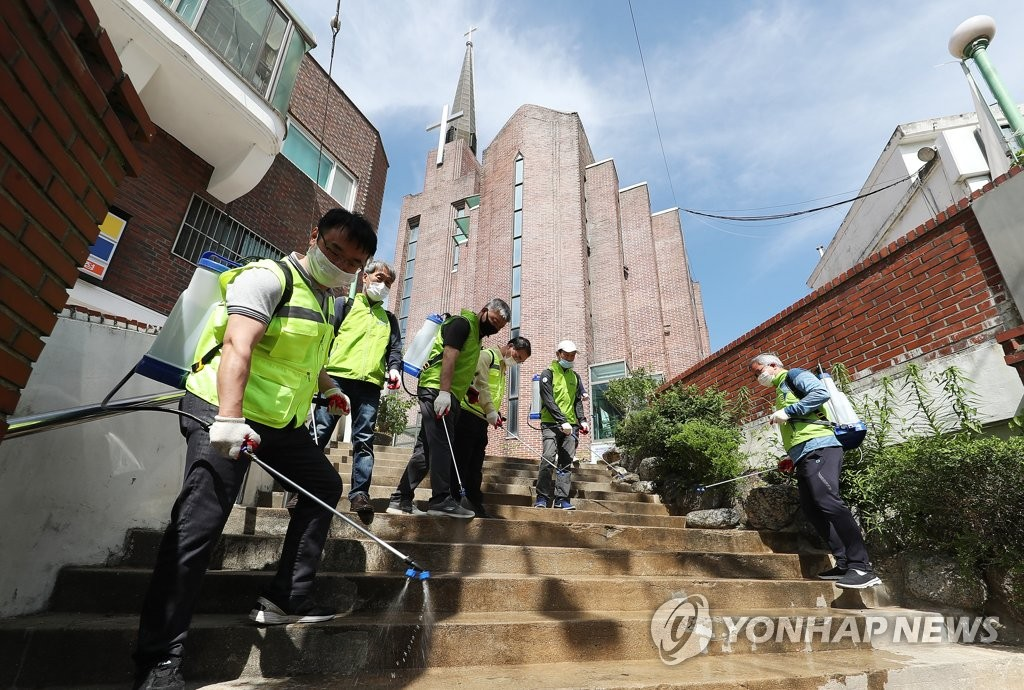 This photo, from June 1, 2020, shows health workers disinfecting a church in Suwon, south of Seoul, where infections occurred in relation to the Coupang logistics center in Bucheon, west of Seoul. (Yonhap)