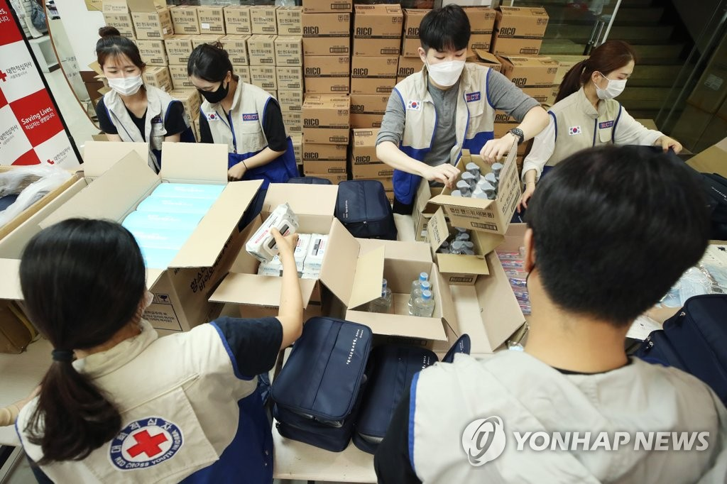 Volunteer workers pack sanitary items, which will be distributed to South Korea's vulnerable groups at the office of the Korean Red Cross, on July 10, 2020. (Yonhap)
