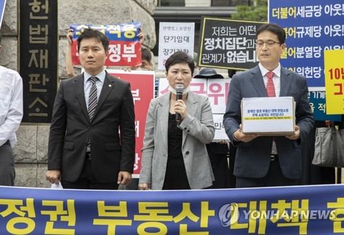 Civic groups file constitutional complaint against gov't property market measures