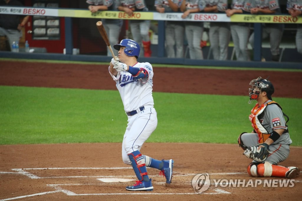 In this file photo from July 29, 2020, Kang Min-ho of the Samsung Lions hits a grand slam against the Hanwha Eagles during a Korea Baseball Organization regular season game at Daegu Samsung Lions Park in Daegu, 300 kilometers southeast of Seoul. (Yonhap)