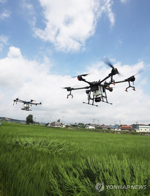 Drones spray pesticide
