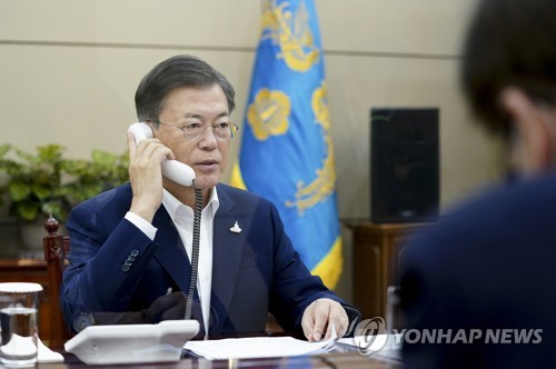 Moon's talks with Japan's new PM