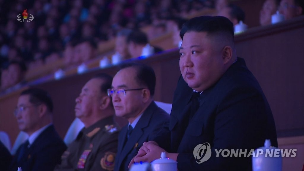 "North Korean leader Kim Jong-un (R) watches art troupes giving a performance, titled ""We Sing of the Party,"" at an indoor stadium in Pyongyang on Jan. 13, 2021, to celebrate the eighth congress of the North's ruling Workers' Party that closed the previous day, in this photo captured from the North's Korean Central Television on Jan. 14. (For Use Only in the Republic of Korea. No Redistribution) (Yonhap)"