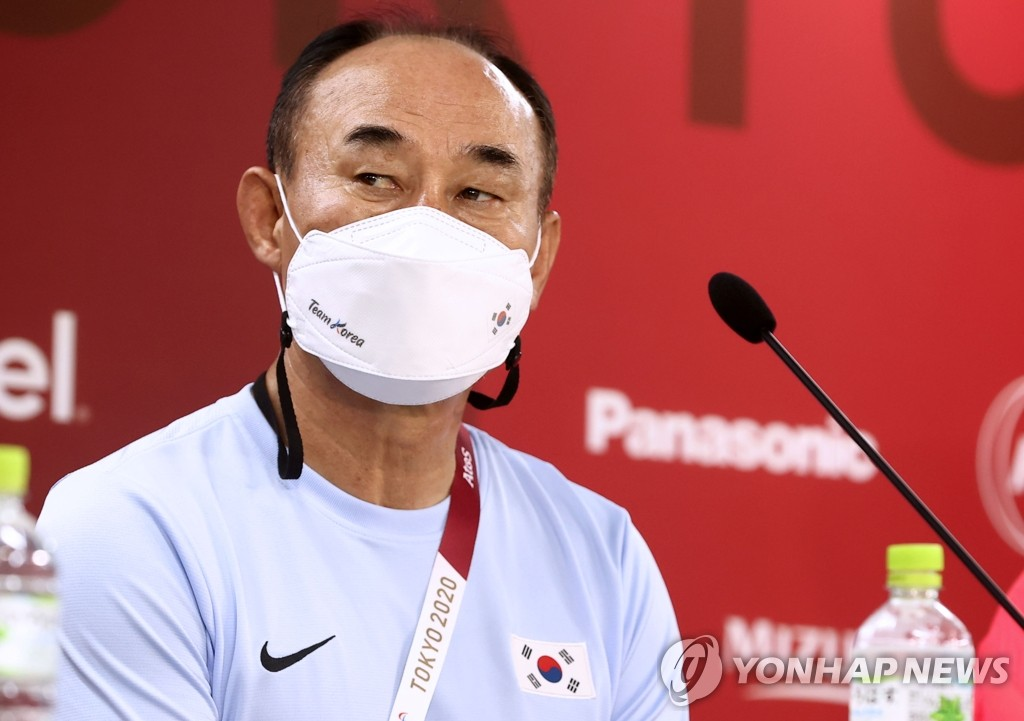 Kim Hak-bum, head coach of the South Korean men's Olympic football team, listens to a question during a press conference at Ibaraki Kashima Stadium in Kashima, Japan, on July 21, 2021. (Yonhap)