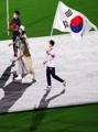 South Korean modern pentathlon bronze medalist Jun Woong-tae carries the national flag,