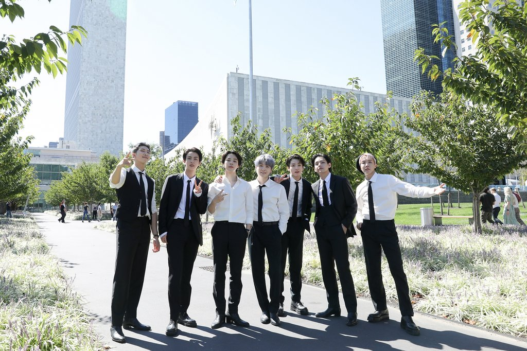 """This photo, provided by Big Hit Music on Sept. 21, 2021, shows K-pop sensations BTS posing in front of the U.N. headquarters. BTS addressed the U.N. General Assembly on Sept. 20, and played a video of the septet performing """"Permission to Dance,"""" in and outside the U.N. headquarters. (PHOTO NOT FOR SALE) (Yonhap)"""