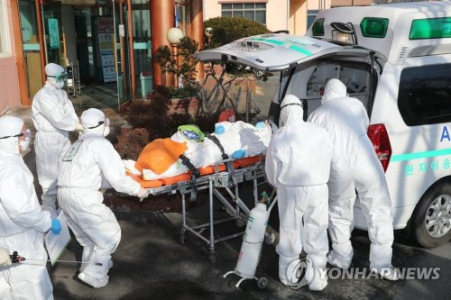 S. Korea reports 2nd virus death as number of infections nearly doubles